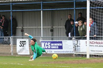 Enfield keeper Joe Wright watches an early shot fly wide
