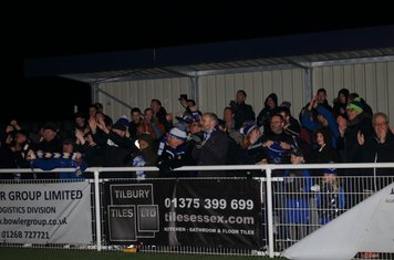 Enfield fans celebrate at the final whistle