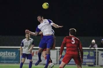 Enfield's Matt Johnson challenges for a header