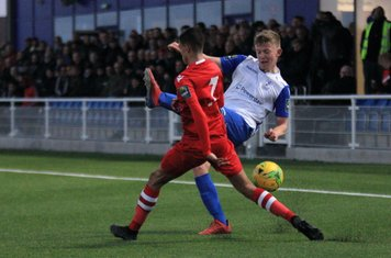 Hornchurch's George Saunders (L) blocks a cross from Joe Payne