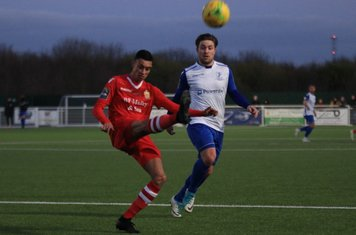 Hornchurch's George Saunders (L) clears from Lewis Taaffe