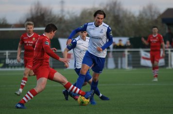 Hornchurch's Glenn Wilson (red) challenges Sam Youngs