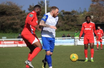 Carshalton's Daniel Pappoe (L) and Christie Pattison and Enfield's Billy Bricknell