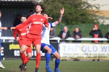Carshalton's Harry Ottaway (red) and Enfield's Matt Johnson
