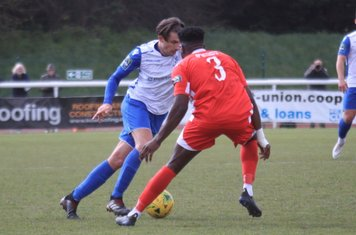 Enfield's Sam Youngs turns inside Paris Hamilton-Downes