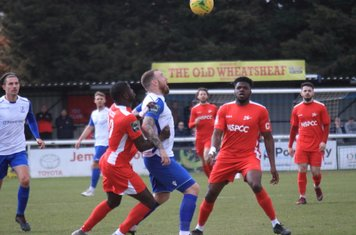 Enfield's Billy Bricknell and Carshalton's Jacob Mendy (L) and Paris Hamilton-Downes