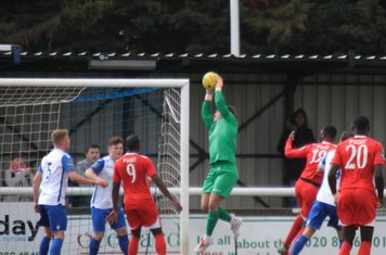 Enfield keeper Joe Wright collects a cross
