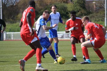 Enfield's Billy Bricknell marked by Jacob Mendy (L), Paris Hamilton-Downes and Luke Read (R)