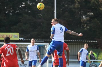 Billy Bricknell heads the ball on