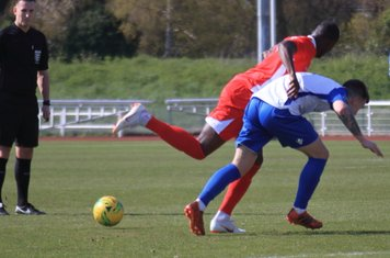 Carshalton's Daniel Pappoe (L) and Enfield's Sam Chaney