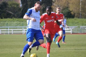 Enfield's Billy Bricknell (L) and Carshalton's Jacob Mendy