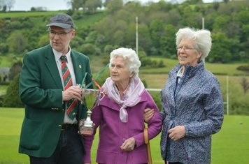 Larne RFC president Paul Montgomery pictured with the Gerry McCullagh trophy, Mrs. McCullagh and Rita McCullagh.