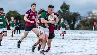Academy overpower Larne at home in the snow.