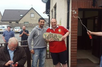 Dyce RFC President Paul Williamson being given a thank you plaque on behalf of Rohit Wadhwani from Sierra Leone rugby association.