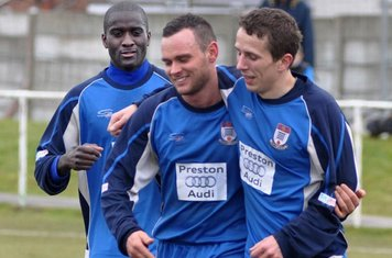 Saydou Bamba and Dave McEvoy celebrate with Luke Walker after his goal  ( Gate's second )