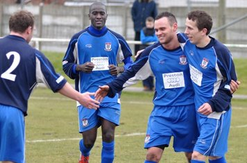 Jamie Nay congratulates Scorer Luke Walker after he had made it two, also in picture Saydou Bamba, and Dave McEvoy, whose header made the goal possible