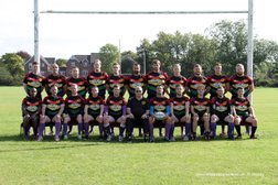 Spartans beat Aldwinians to earn promotion.