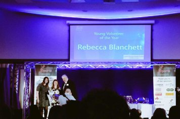 Rebecca collecting her award