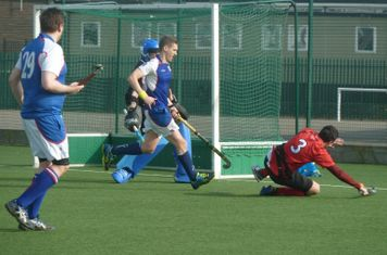 Bryn Owen playing the ball towards goal