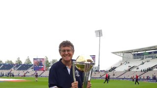 Trevor Foreman carrying the Cricket World Cup Trophy