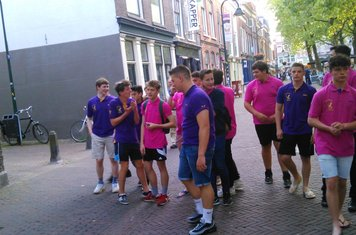 The teams walking into Delft for the team dinner