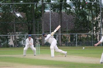 Adeel goes for the big hit - not sure about the footwork though mate.