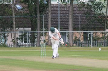 Simon Tucker clips one off his pads into the legside