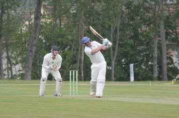Chris hits out on his way to a half century.