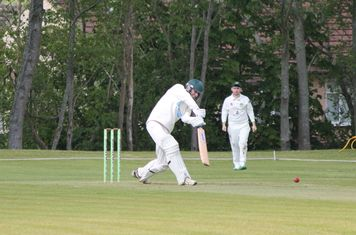 Michael Brown drives against Eccleshall