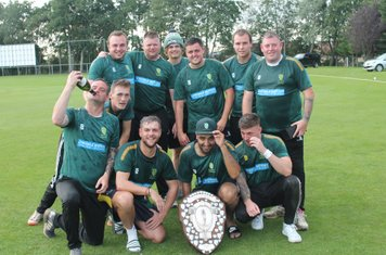 The victorious team with the trophy - well done lads.