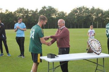 Brian Lawton presents Burslem Captain Alex Gilson with his winners medal.