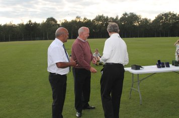 The Umpires (Philip White and Peter Pathak) are presented with medals from Brian Lawton.
