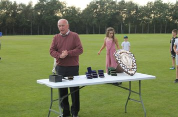 North Staffs and South Cheshire League Chairman Brian Lawton gets ready to present the medals and the trophy.