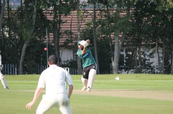 Junaid Qureshi drives through the covers on his way to making 39.