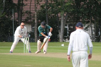 Junaid Qureshi watches the ball closely.