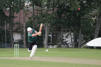 Gareth Abbotts thinks he's a Flamingo as he goes over the top into the legside.