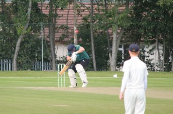 Daniel Reed takes evasive action from a short ball from Shaun Brian.