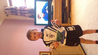 Elliott proudly wearing kit for first time