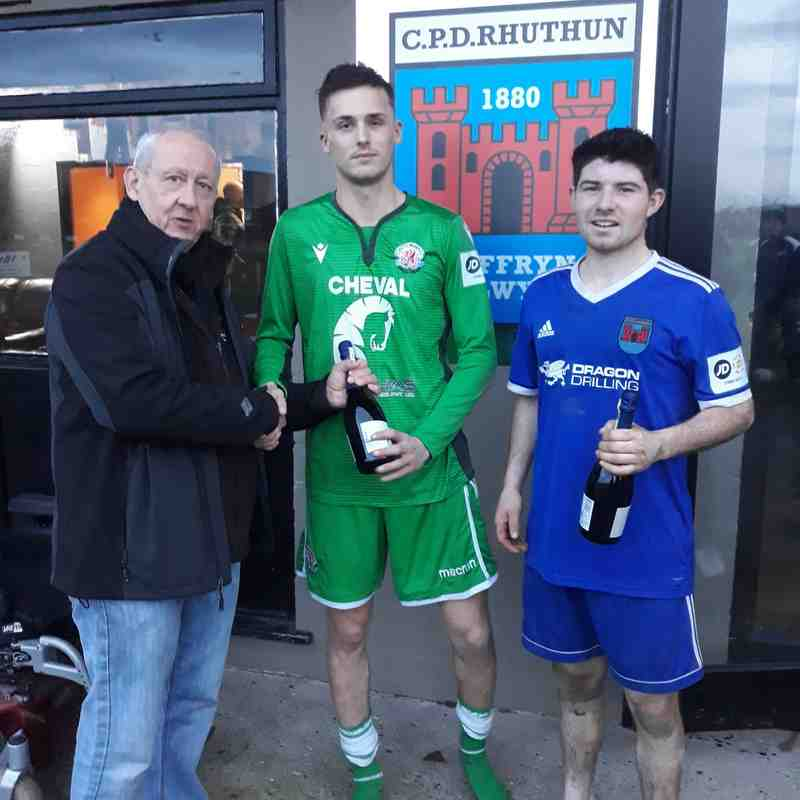 Tom Williams (Corwen, green) and Osian Davies are presented their man of the match awards from sponsors Dragon Drilling.