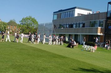 Players shake hands after a Guildford victory.