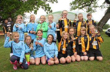 Woodley United and Thatcham Tornadoes U9 Girls with their trophies