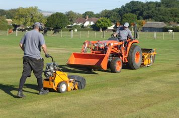 Keith and Lewis of SGC scarifying the square.e