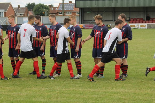 More players shaking hands before kick off.