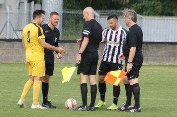 Officials and captains before kick off.