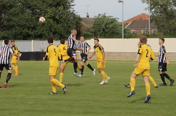 Nathan Peat flicking the ball on.