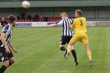 Byron Littlefair heading the ball.
