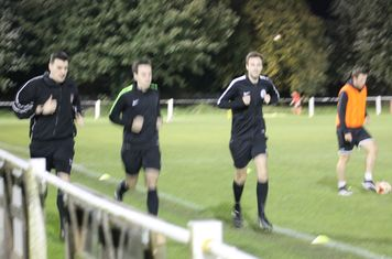 The officials warming up.