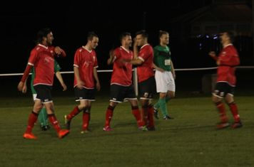 Steve Bromley being congratulated for scoring.