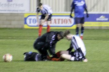 Terry Gowing treating Ryan Thompson.