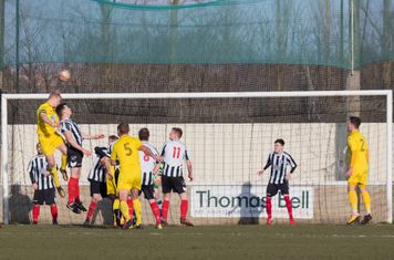 Will Lenehan and George Merrick contesting a header.